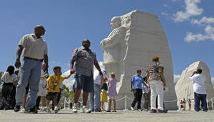Photo -   People view the new Martin Luther King, Jr., Memorial in Washington, Monday, Aug. 22, 2011. (AP Photo/Susan Walsh)
