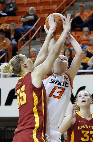 Photo - OKLAHOMA STATE UNIVERSITY / OSU: Oklahoma State's Morgan Toben (13) shoots over Iowa State's Anna Prins (55) during the women's college basketball game between Oklahoma State and Iowa State at  Gallagher-Iba Arena in Stillwater, Okla.,  Sunday,Jan. 20, 2013.  OSU won 71-42. Photo by Sarah Phipps, The Oklahoman