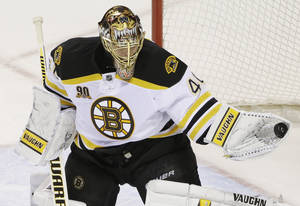 Photo - Boston Bruins goalie Tuukka Rask (40), of Finland, make a save against the San Jose Sharks during the first period of an NHL hockey game on Saturday, Jan. 11, 2014, in San Jose, Calif. (AP Photo/Marcio Jose Sanchez)