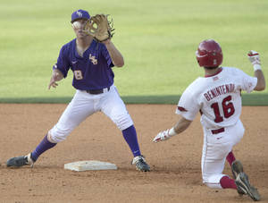 Photo - LSU's Alex Bregman takes the throw to force Arkansas' Andrew Benintendi  out at second during the Southeastern Conference NCAA college baseball tournament on Thursday, May 22, 2014, in Hoover, Ala. (AP Photo/Hal Yeager)