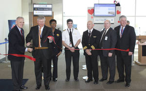 Photo - Officials on Thursday with Will Rogers World Airport and United Airlines celebrate the first nonstop flight between Oklahoma City and Cleveland.