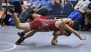 photo - California&#039;s Kevin Coburn, top, wrestles Florida&#039;s Alejandro Sancho in the 125-pound weight class during the Junior National Duals at the Freede Wellness Center on the Campus of Oklahoma City University in Oklahoma City, Saturday, June 25, 2011.  Photo by Bryan Terry, The Oklahoman  ORG XMIT: KOD