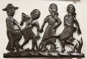 Photo - This metal wall hanging from Haiti is one of the items for sale at  Pambe Ghana Global Market. Photo By David McDaniel, The Oklahoman. <strong>David McDaniel - The Oklahoman</strong>