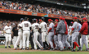 Photo -   San Francisco Giants and Cincinnati Reds' benches clear after Giants pitcher Ryan Vogelsong was nearly hit by a pitch thrown by Reds' Bronson Arroyo in the sixth inning of a baseball game, Sunday, July 1, 2012, in San Francisco. (AP Photo/Ben Margot)