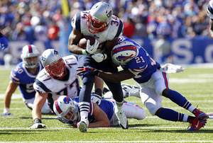 Photo - Buffalo Bills cornerback Leodis McKelvin (21) tackles New England Patriots' Shane Vereen (34) during the second half of an NFL football game on Sunday, Sept. 8, 2013, in Orchard Park. (AP Photo/Bill Wippert)