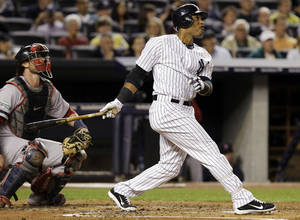 Photo -   New York Yankees' Robinson Cano hits a second-inning, solo home run during their baseball game against the Boston Red Sox at Yankee Stadium in New York, Monday, Oct. 1, 2012. (AP Photo/Kathy Willens)
