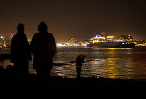 Photo - Spectators watch the 528-foot, $165 million Nova Star ferry leave Portland, Maine on its maiden voyage to Yarmouth, Nova Scotia, Canada, Thursday night, May 15, 2014. (Photo/Robert F. Bukaty)