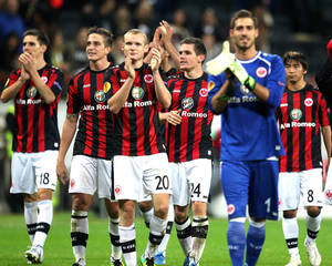Photo - Frankfurt players celebrate after a Europa League group F soccer match between Eintracht Frankfurt and Maccabi Tel Aviv in Frankfurt,  Germany Thursday, Oct.24, 2013.  Frankfurt won 2-0.(AP Photo/Michael Probst)