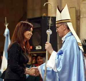 Photo - FILE - In this Dec. 12, 2008 file photo, Argentina's President Cristina Fernandez, left, shakes hands with Buenos Aires' archbishop Jorge Mario Bergoglio in Lujan, Argentina.  Bergoglio, who chose the name of Francis, was chosen as the 266th pontiff of the Roman Catholic Church on March 13, 2013. Pope Francis has honed his leadership skills in one of the most difficult classrooms on the planet: Argentina, where politics has long been a blood sport practiced only by the brave. (AP Photo/DyN, File)