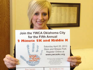 Photo - Karla Docter, the senior director of sexual assault services at the YWCA Oklahoma City, displays a poster for the event. Photo provided