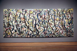 "Photo - Jackson Pollock's ""Mural,"" 1943, as installed at the J. Paul Getty Museum in Los Angeles on Monday, March 10, 2014. The oil-on-canvas work, measuring more than 8 feet high and nearly 20 feet long, has been under wraps at the J. Paul Getty Museum for more than a year undergoing extensive restoration. The painting, owned by the University of Iowa, will be on display at The J. Paul Getty Museum for three months, from March 11 to June 1, 2014 at the Getty Center. (AP Photo/Nick Ut )"