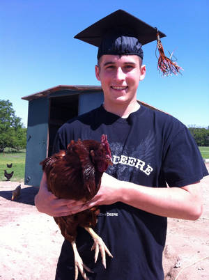 Photo - Calvan Parker of Okemah with his prized hen Ima Layer. <strong>SHERREL JONES - THE OKLAHOMAN</strong>