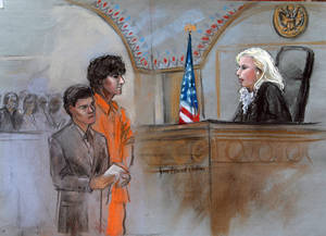 Photo - CORRECTS ID OF ATTORNEY TO MIRIAM CONRAD INSTEAD OF JUDY CLARKE - This courtroom sketch depicts Boston Marathon bombing suspect Dzhokhar Tsarnaev standing with his lawyer Miriam Conrad, left, before Magistrate Judge Marianne Bowler, right, during his arraignment in federal court Wednesday, July 10, 2013 in Boston. The 19-year-old has been charged with using a weapon of mass destruction, and could face the death penalty. (AP Photo/Jane Flavell Collins)