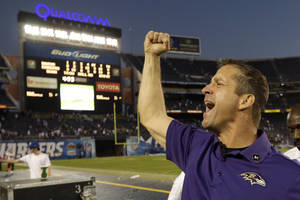 Photo -   Baltimore Ravens head coach John Harbaugh celebrates after his team defeated the San Diego Chargers in an NFL football game, Sunday, Nov. 25, 2012, in San Diego. The Ravens won 16-13 in overtime. (AP Photo/Gregory Bull)