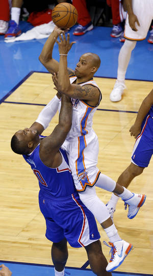 Photo - Oklahoma City's Caron Butler (2) gets called for an offensive foul as he runs into Los Angeles' Glen Davis (0) during Game 1 of the Western Conference semifinals in the NBA playoffs between the Oklahoma City Thunder and the Los Angeles Clippers at Chesapeake Energy Arena in Oklahoma City, Monday, May 5, 2014. Photo by Bryan Terry, The Oklahoman