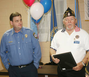 Photo - Robert L. Carr, American Legion  Post 216 commander, presents Oklahoma City Fire Department Maj. Kenneth Rolke a community service award. POHTO PROVIDED <strong>PROVIDED</strong>