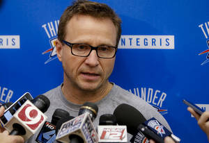 Photo - Coach Scott Brooks speaks to the press during media availability at the Oklahoma City Thunder practice facility on Friday, May 30, 2014 in Oklahoma City, Okla. Photo by Chris Landsberger, The Oklahoman