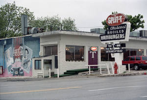 photo - RESTAURANT / 1994 / REOPEN / REOPENING: Orig. caption: With little fanfare, the Split-T, 5500 N Western, has reopened under new management.  April 30, 1994. Photo by Doug Hoke, The Oklahoman ORG XMIT: KOD
