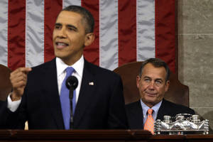 photo - House Speaker John Boehner of Ohio listens at right as President Barack Obama gives his State of the Union address during a joint session of Congress on Capitol Hill in Washington, Tuesday Feb. 12, 2013. (AP Photo/Charles Dharapak, Pool)