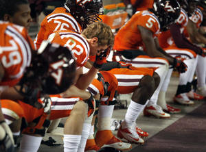 Photo - Virginia Tech wide receiver Willie Byrn (82) and his teammates sit as time runs out and Duke wins 13-10 in Blacksburg, Va., Saturday, Oct. 26, 2013. (AP Photo/The Roanoke Times, Matt Gentry)