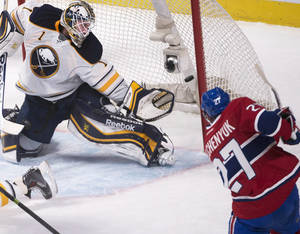 Photo - Montreal Canadians' Alex Galchenyuk shoots on Buffalo Sabres goalie Jhonas Enroth (1) during second period NHL action in Montreal, Saturday, Dec.7, 2013. (AP Photo/The Canadian Press, Peter McCabe)