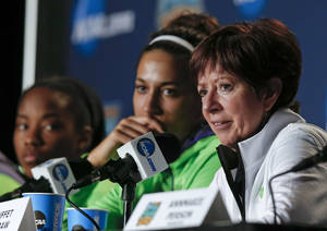 Photo - Notre Dame head coach Muffet McGraw, right, answers questions during a news conference at the NCAA women's Final Four college basketball tournament Monday, April 7, 2014, in Nashville, Tenn. Notre Dame is scheduled to face Connecticut in the championship game Tuesday. (AP Photo/John Bazemore)