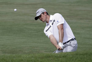 Photo - Justin Rose of England, chips from the fairway to the 11th green from during the third round of The Players championship golf tournament at TPC Sawgrass, Saturday, May 10, 2014, in Ponte Vedra Beach, Fla. (AP Photo/John Raoux)