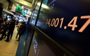 photo - A screen on the trading floor of the New York Stock Exchange, on Friday, Feb. 1, 2013, shows the Dow Jones industrial average above 14,000 for the first time since October 2007. Evidence that the U.S. economic recovery is firmly on track drove markets higher on Friday, adding to the cheer from good economic indicators out of Europe. (AP Photo/Richard Drew)