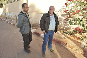photo - Two British hostages Peter, left, and Alan, right, (no family name available), are seen after being released, in a street of Ain Amenas, near the gas plant where they have been kidnapped by Islamic militants, Saturday, Jan. 19, 2013. Algeria's special forces stormed the natural gas complex in the middle of the Sahara desert in a final assault Saturday, killing 11 militants, but not before they in turn killed seven hostages, the state news agency reported.(AP Photo/Anis Belghoul)