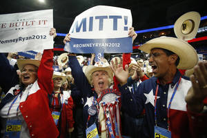 Photo -   Texas delegates cheer as Mitt Romney is nominated for the Office of the President of the United States at the Republican National Convention in Tampa, Fla., on Tuesday, Aug. 28, 2012. (AP Photo/Jae C. Hong)