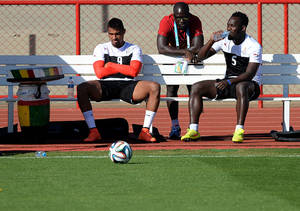 Photo - Ghana's Kevin Prince Boateng, left, and Michael Essien, right, wait for a training session in Brasilia, Brazil, Wednesday, June 25, 2014. Ghana will play Portugal in group G of the 2014 soccer World Cup on June 26. (AP Photo/Paulo Duarte)