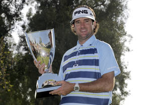 Photo - Bubba Watson holds the winner's trophy after victory in the Northern Trust Open golf tournament at Riviera Country Club in the Pacific Palisades area of Los Angeles, Sunday, Feb. 16, 2014. Watson carded a 15-under-par 269, two strokes ahead of the second-place finisher. (AP Photo/Reed Saxon)