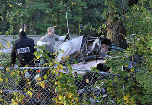 photo -   New York State Troopers investigate the scene of car accident that occurred early Monday, Oct. 8, 2012, on the Southern State Parkway westbound near exit 17 Hempstead Avenue on in West Hempstead, N.Y. New York State police say four people were killed in the one-car accident, and a fifth person was taken to a hospital. (AP Photo/Kathy Kmonicek)