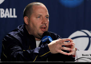 Photo - Marquette head coach Buzz Williams, answers a question after practice   Thursday, March 24, 2011, in Newark, N.J., for an East regional semifinal game in the NCAA college basketball tournament. (AP Photo/Mel Evans) ORG XMIT: NJME108
