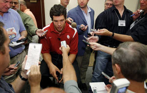Photo - OU quarterback Sam Bradford meets the media on Tuesday. Photo by Bryan Terry, The Oklahoman.