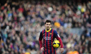 Photo - FC Barcelona's Lionel Messi, looks on against Valencia during a Spanish La Liga soccer match at the Camp Nou stadium in Barcelona, Spain, Saturday, Feb. 1, 2014. (AP Photo/Manu Fernandez)