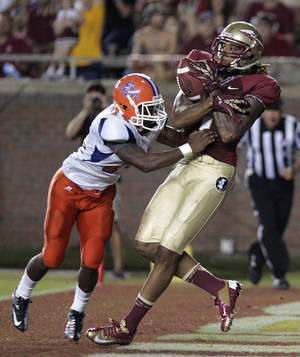 photo -   Florida State's Kevin Benjamin pulls in a Touchdown pass past the defense of Savannah State's Wayne Johnson in the third quarter of an NCAA college football game on Saturday, Sept. 8, 2012, in Tallahassee, Fla. Florida State won the weather-shortened game 55-0. (AP Photo/Steve Cannon)