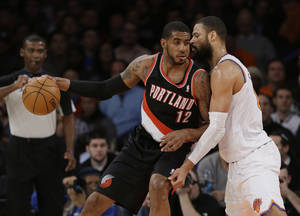 Photo - New York Knicks' Tyson Chandler (6) defends Portland Trail Blazers' LaMarcus Aldridge (12) during the first half of an NBA basketball game Wednesday, Feb. 5, 2014, in New York. (AP Photo/Frank Franklin II)
