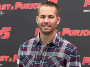 "Photo - FILE - In this April 29, 2011 file photo, actor Paul Walker poses during the photo call of the movie ""Fast and Furious 5,"" in Rome. Walker's daughter Meadow Rain Walker will live with her mother and a nanny, a court appointed attorney told a Los Angeles Superior Court commissioner during a hearing on Wednesday, May 28, 2014. Commissioner David Cowan dismissed a guardianship proceeding over the 15-year-old after hearing details about who will care for her. (AP Photo/Andrew Medichini, File)"