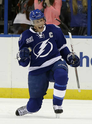 photo - Tampa Bay Lightning center Vincent Lecavalier celebrates after scoring against the Philadelphia Flyers during the first period of an NHL hockey game Sunday, Jan. 27, 2013, in Tampa, Fla. (AP Photo/Chris O'Meara)