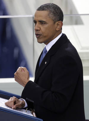 photo - President Barack Obama delivers his Inaugural address at his ceremonial swearing-in at the U.S. Capitol during the 57th Presidential Inauguration in Washington, Monday, Jan. 21, 2013. (AP Photo/Evan Vucci)