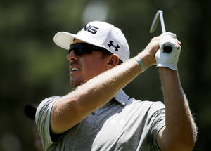 Photo - Hunter Mahan watches his tee shot on the third hole during a practice round for the U.S. Open golf tournament in Pinehurst, N.C., Tuesday, June 10, 2014. The tournament starts Thursday. (AP Photo/David Goldman)