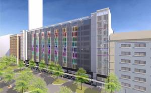 photo - The proposed new garage along Main Street is shown in this rendering at nine stories high. Revised plans call for 10 stories of parking with an additional three stories of housing. Drawing provided by TAP Architecture