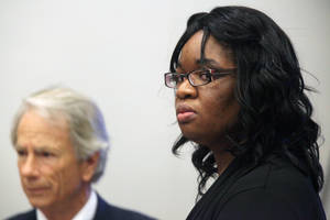 photo -   FILE - In this Oct. 24, 2012 file photo, Jessica Tata, accused in the deaths of four children at her west Houston daycare, stands at the conclusion of opening statements at the Harris County Criminal Courthouse, in Houston. Tata, 24, is charged with four counts of felony murder but is currently being tried in the death of 16-month-old Elias Castillo. She faces up to life in prison if convicted. (AP Photo/Houston Chronicle, Mayra Beltran, File)  