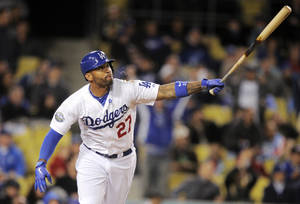 Photo - Los Angeles Dodgers' Matt Kemp spits as he hits a two-run home run during the fifth inning of their baseball game against the San Diego Padres, Friday, April 13, 2012, in Los Angeles. (AP Photo/Mark J. Terrill) ORG XMIT: LAD108