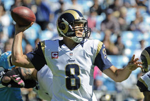 Photo - St. Louis Rams quarterback Sam Bradford (8) looks to pass against the Carolina Panthers in the first half of an NFL football game in Charlotte, N.C., Sunday, Oct. 20, 2013. (AP Photo/Mike McCarn)