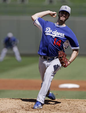 Photo - Los Angeles Dodgers starting pitcher Dan Haren throws during the second inning of a spring exhibition baseball game against the Kansas City Royals, Tuesday, March 11, 2014, in Surprise, Ariz. (AP Photo/Darron Cummings)