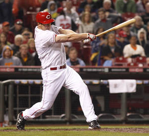 Photo -   Cincinnati Reds' Scott Rolen hits a four-run home run in the seventh inning of a baseball game against the San Francisco Giants, Wednesday, April 25, 2012, in Cincinnati. (AP Photo/Ernest Coleman)