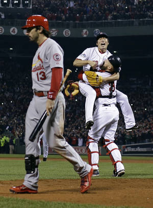 Photo - Boston Red Sox relief pitcher Koji Uehara and catcher David Ross celebrate after getting St. Louis Cardinals' Matt Carpenter to strike out and end Game 6 of baseball's World Series Wednesday, Oct. 30, 2013, in Boston. The Red Sox won 6-1 to win the series. (AP Photo/Matt Slocum)