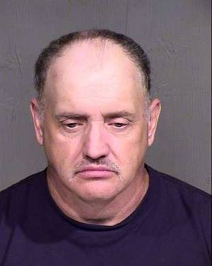 Photo - This image provided by the Maricopa County Ariazona Sheriff's Office shows the booking photo of David Lee Simpson.  Simpson was booked Wednesday July 24, 2013 for making threats via twitter. Cable newscasters Nancy Grace and Jane Velez-Mitchell were the victims of the online threats that the New York man made because he was upset with their coverage of the Jodi Arias trial, Arizona authorities said Wednesday.  (AP Photo/Maricopa County Arizona Sheriff's Office)